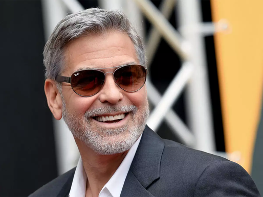 Clooney Gives $1m to 14 Friends