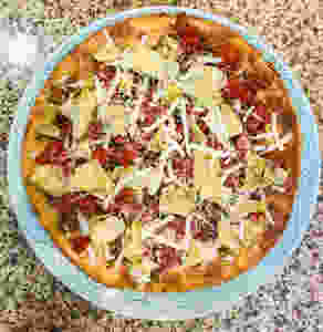 Yummy vegan Italian style pizza with garlic, tomato, olives, cheese and artichoke