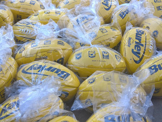 Santa delivers new footy's for 2017