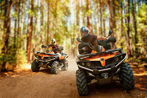 Two atv riders, speed race in forest, fr