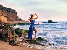 Blue-dress-girl-at-coast-rocks-sea_1920x