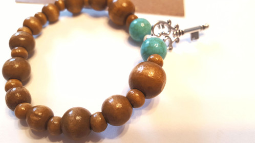 Key Charm Beaded Stretch Bracelet This Has A Single Metal With Small White Separators Then It Transitions To Two Turquoise Shattered Beads