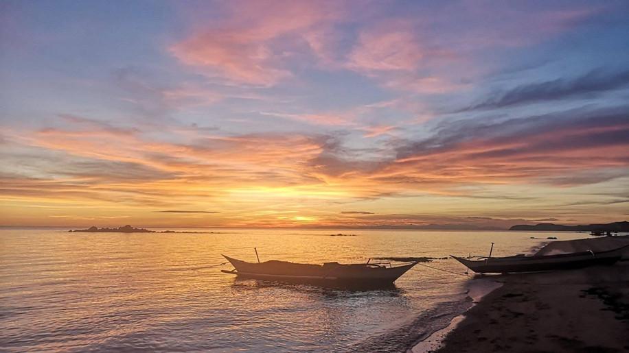 pili-beach-resort-sunset-boat.jpg
