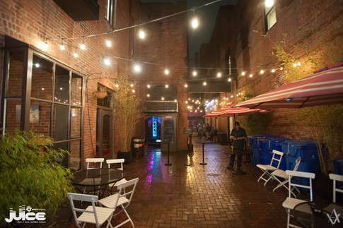 The beautifully lit patio outside the Whiskey Bar before the night opened.