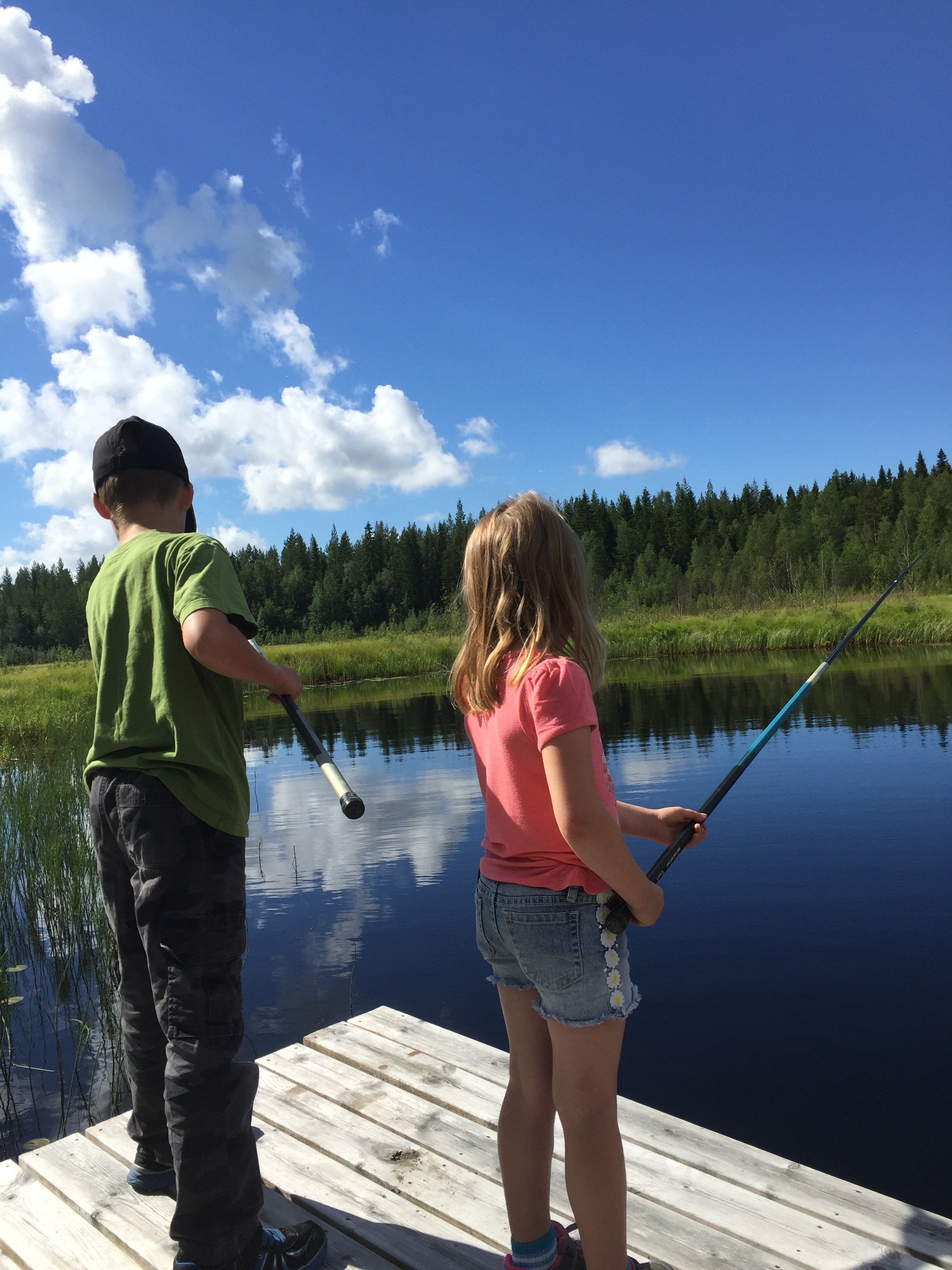 Family fishing on the farm