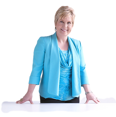 Judy Gaman_ Author, CEO, Speaker standing behind a table smiling_edited_edited_edited_edit