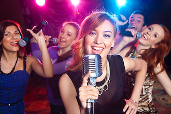 Young girl singing into  microphone at