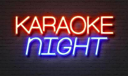 Karaoke night neon sign on brick wall ba