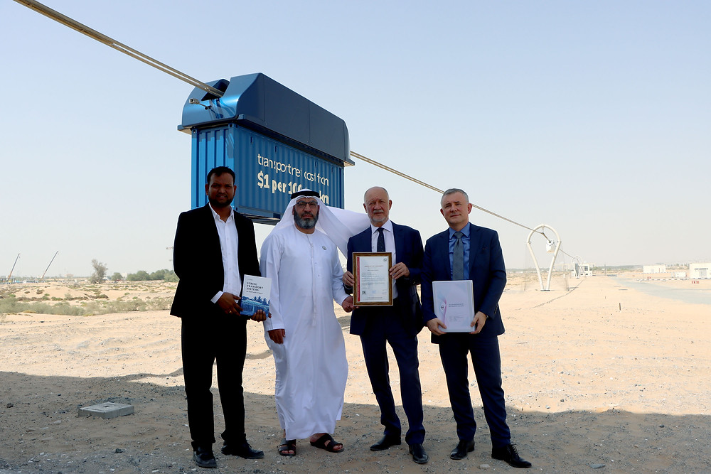 Representatives of the developer and certification body in front of unique electric vehicle uCont