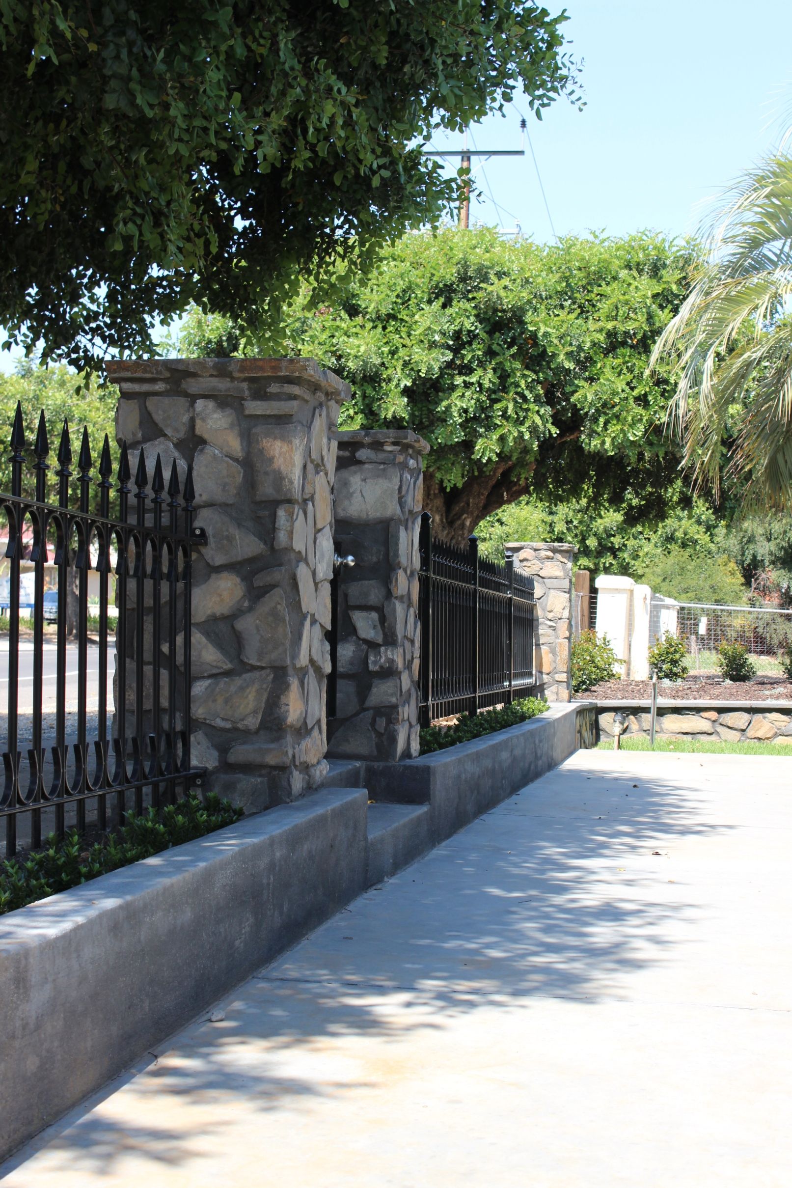 Stone front fence