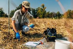 soil-thermometer-female-agronomist-measu