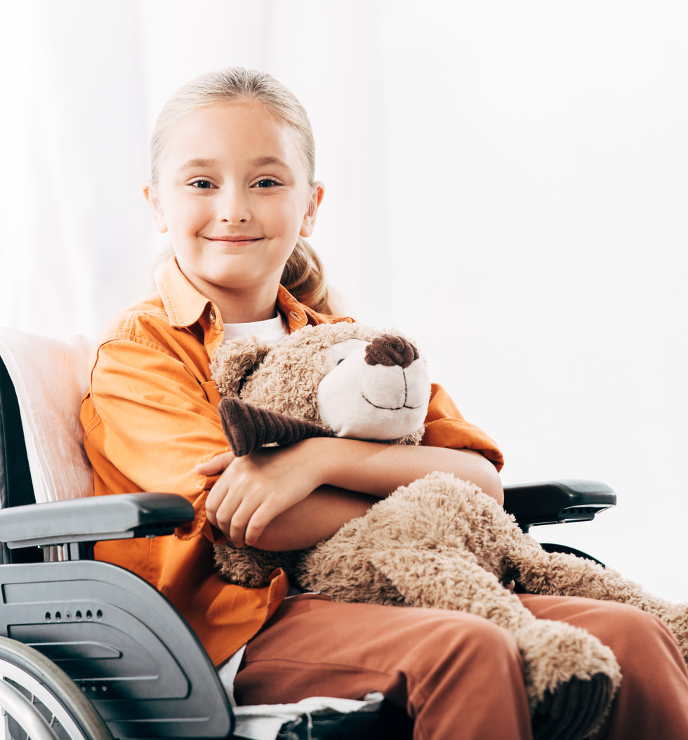 smiling-kid-holding-teddy-bear-and-sitti