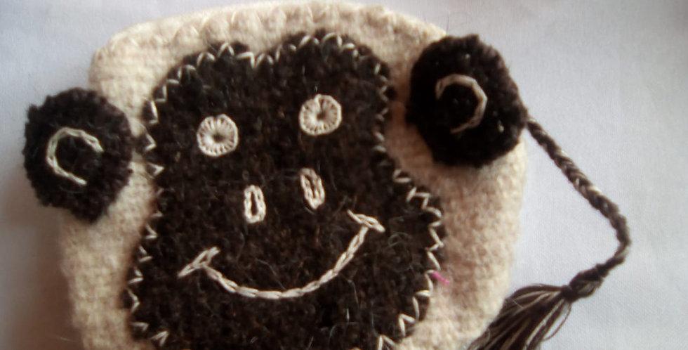 Monederos de lana con forma de animalitos
