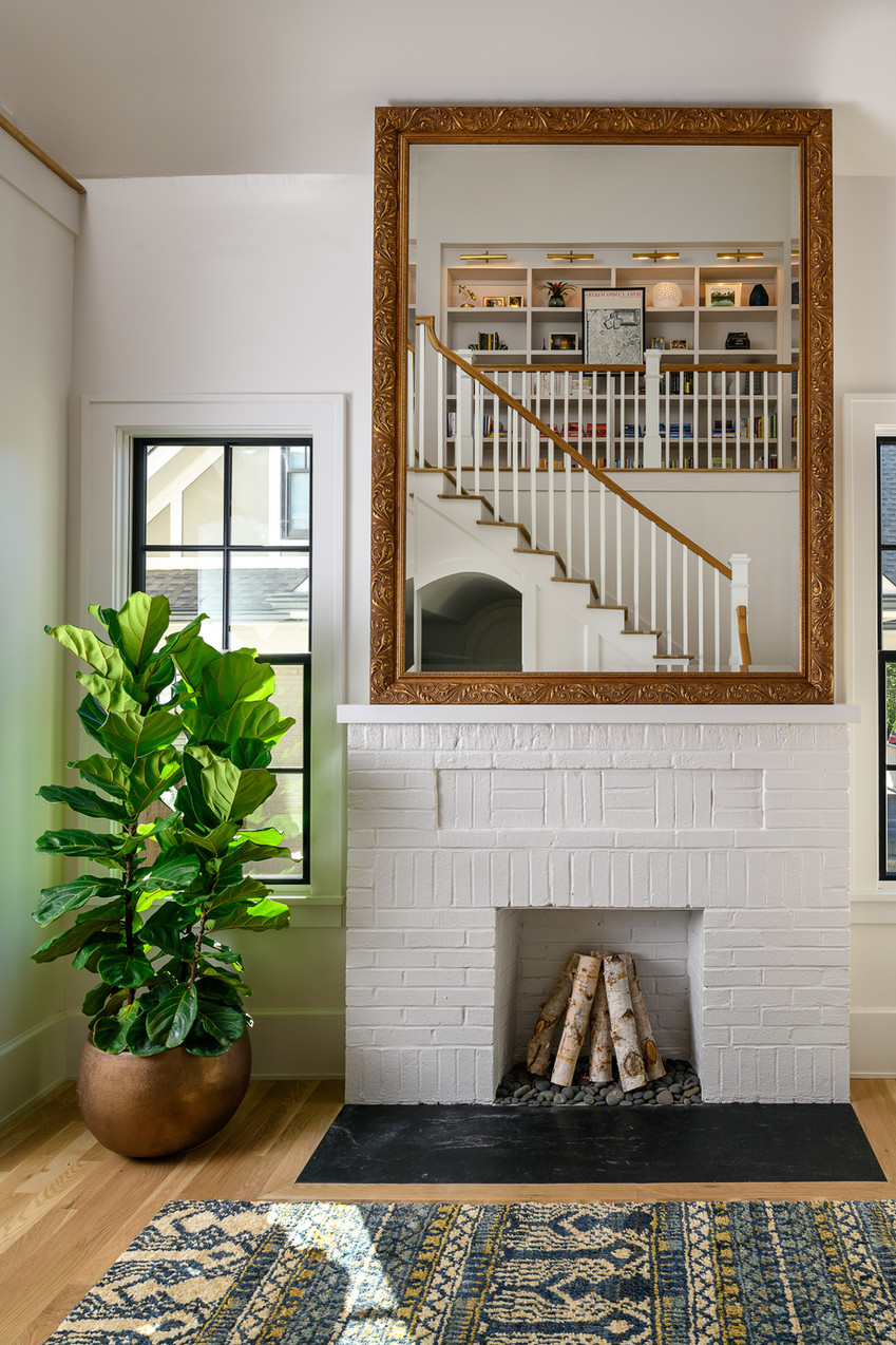 mcrae - entry showing fireplace and mirr