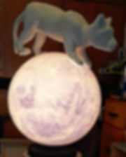"""""""Moon Tide Lion"""" in my studio. 20"""" acrylic globe painted on inside. Carved styrofoam coated with foamcoat."""