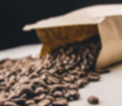 Coffee bag spilling coffee beans