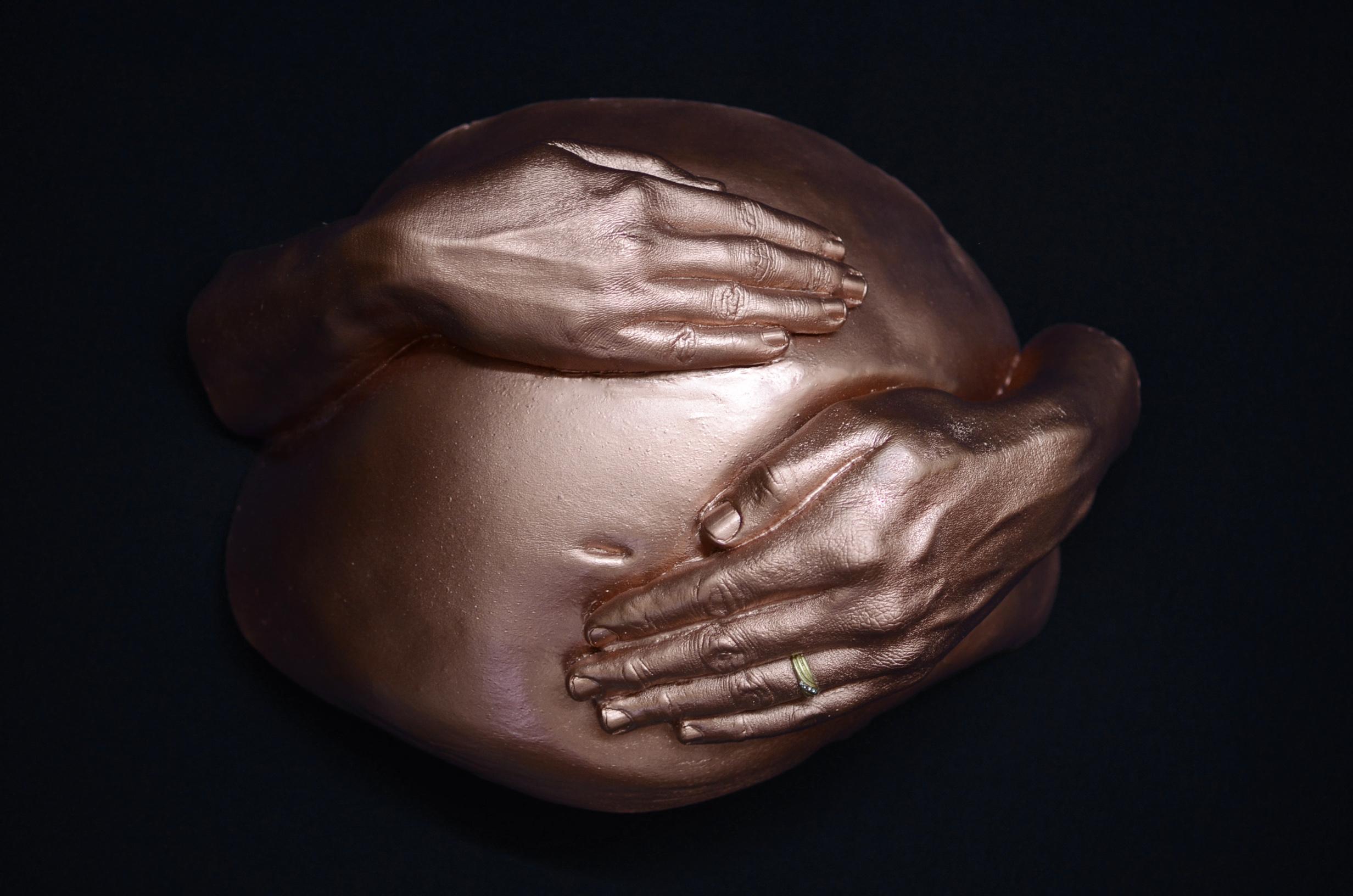 Tummy with mom & dad hand
