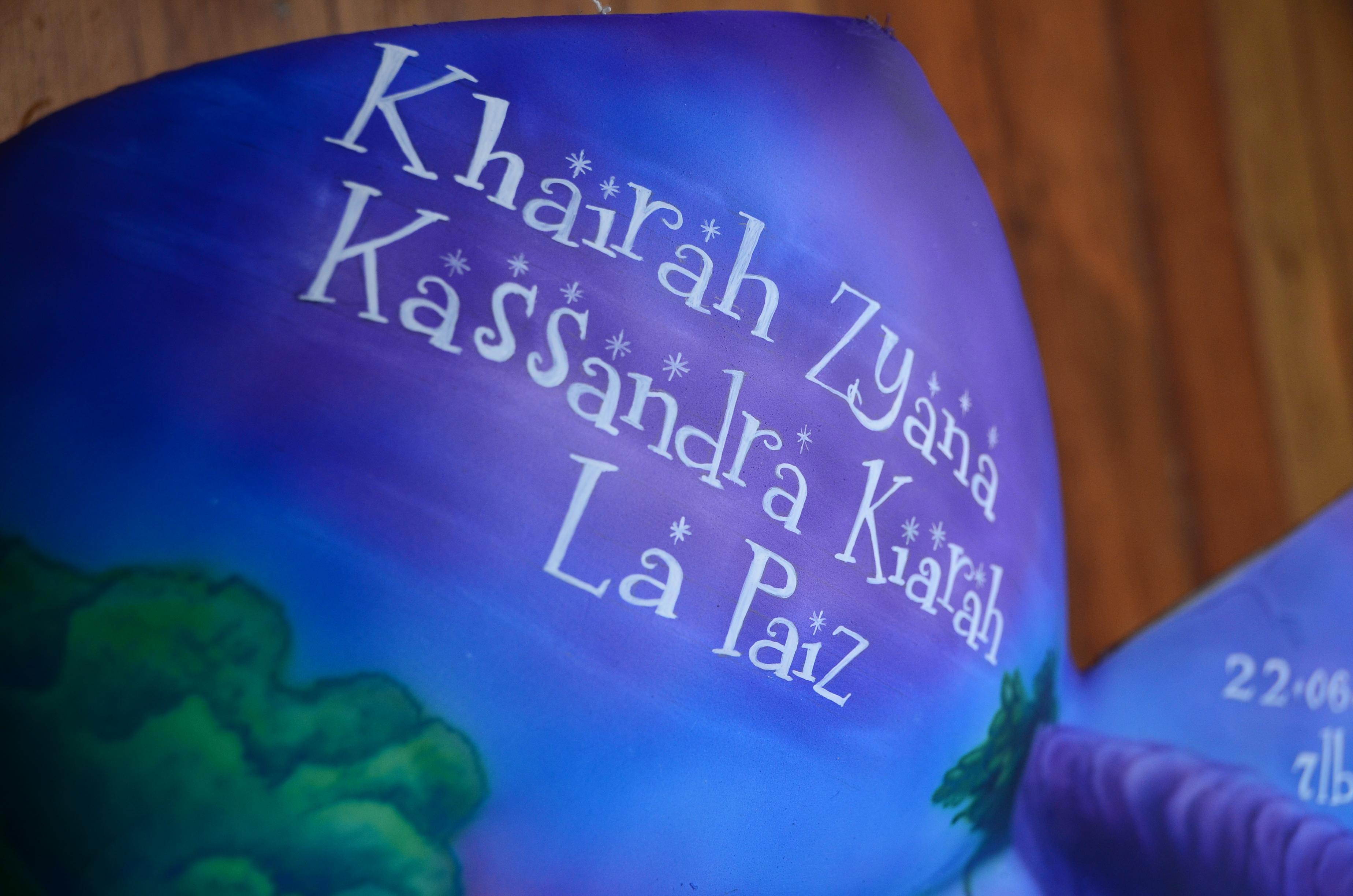 Baby's name hand written.