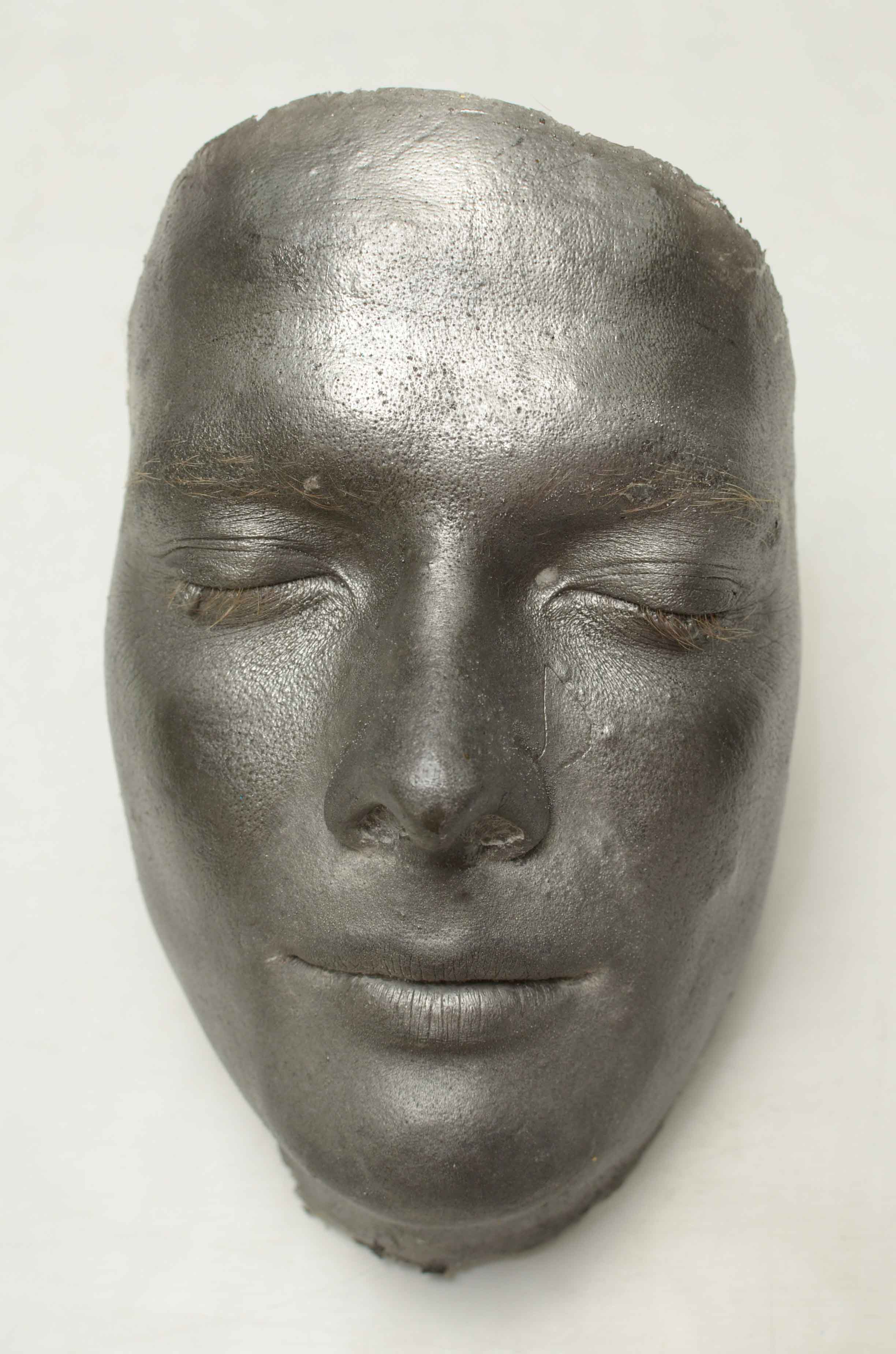 Frontal view of face cast.