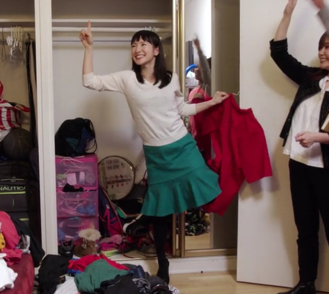 """Marie Kondo demonstrates the """"ting"""" of joy-sparking objects."""