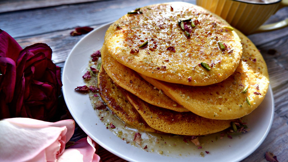 Persian Saffron Love Pancake drizzled with rosewater, cream and cardamom syrup