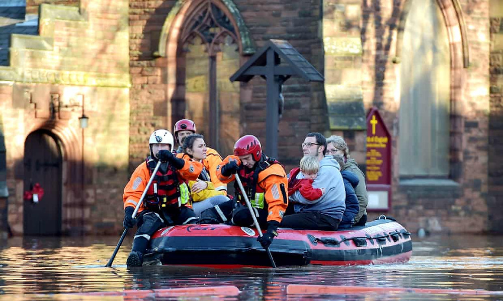 The aftermath of Storm Desmond in Carlisle. The research showed that river defences prevented £2.2bn worth of damage in Cumbria in December 2015. Photograph: Jeff J Mitchell/Getty Images