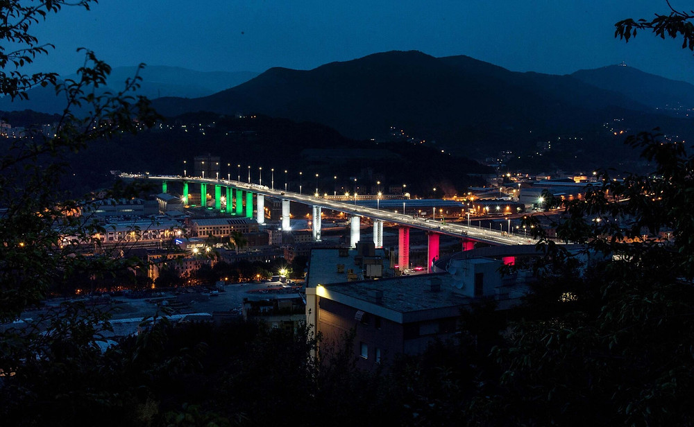 New Genoa bridge illuminated with the colours of the Italian flag days before its inauguration.