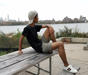 a man wearing Stemp Men's hemp shorts and tee and sitting on a bench