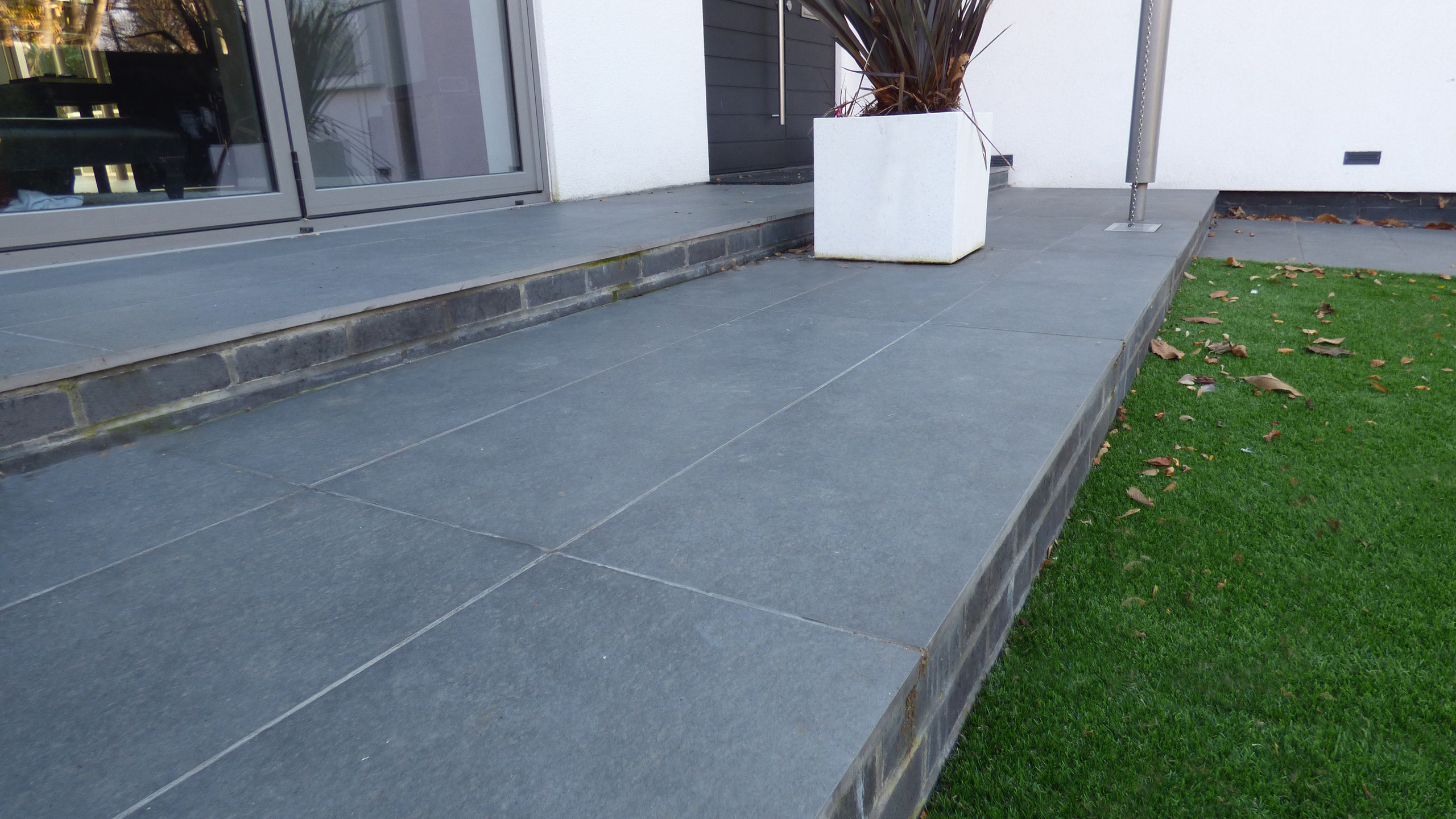 Installed Brett Porcelain paving in Night Sky, at the front and rear of this property in Tunbridge Wells
