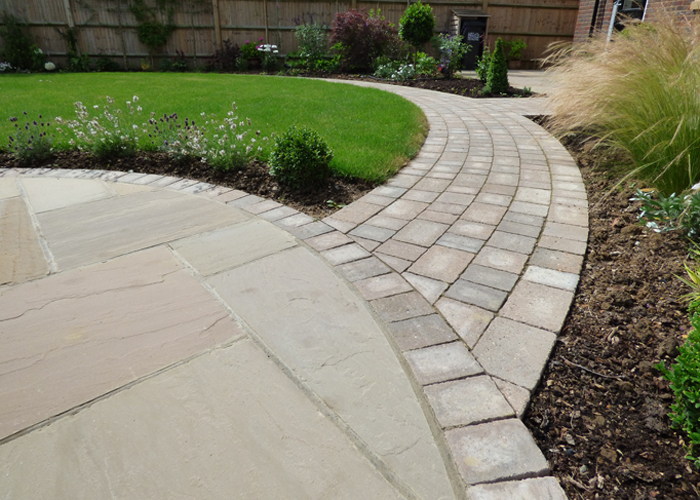 Brett Sandstone Patio with Alpha Antique pathways.