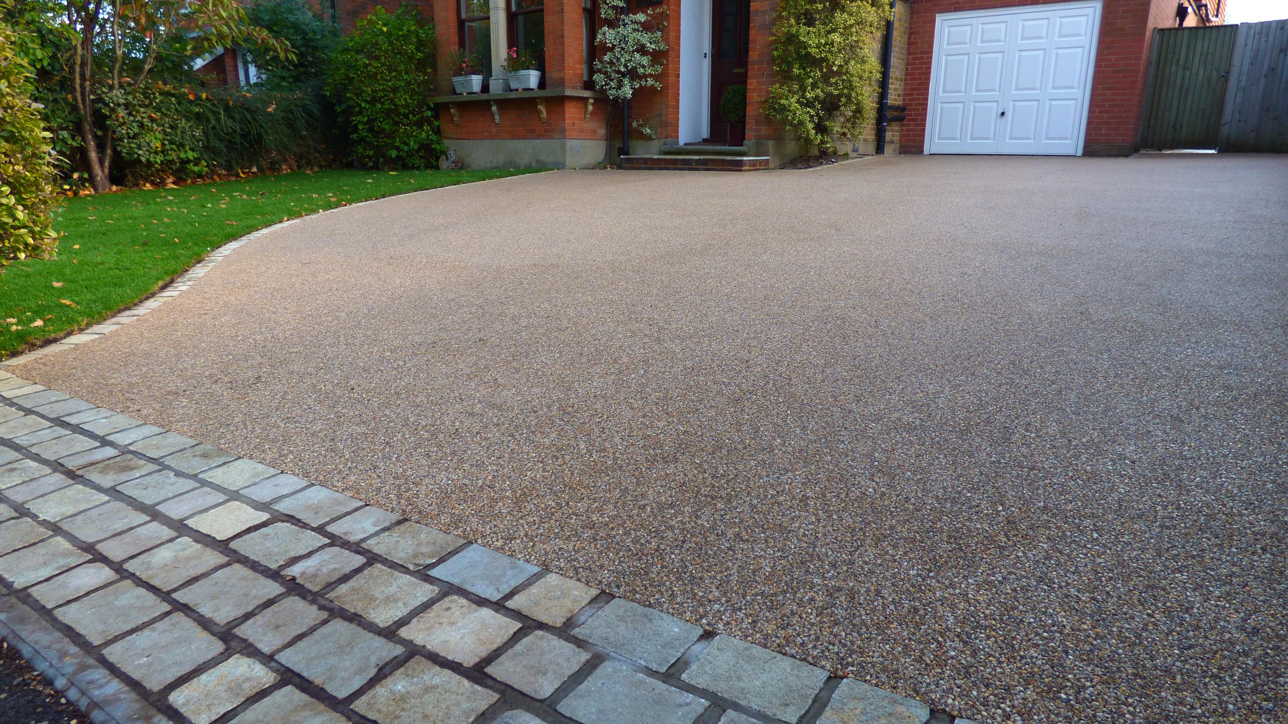 Resin Bound Driveway with granite sett apron