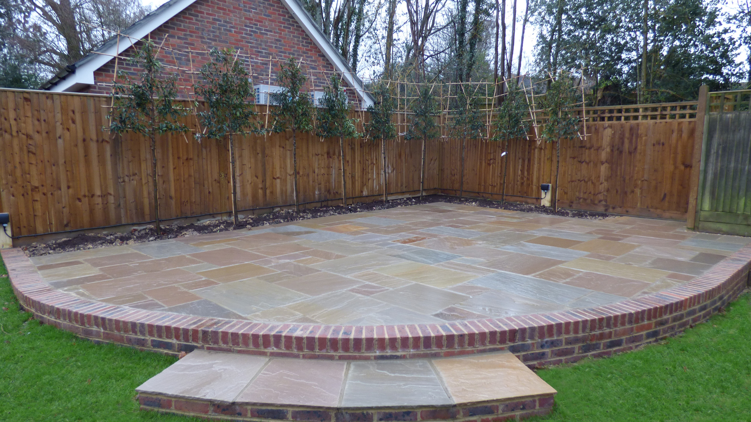 Brett Natural Sandstone Patio with brick edging