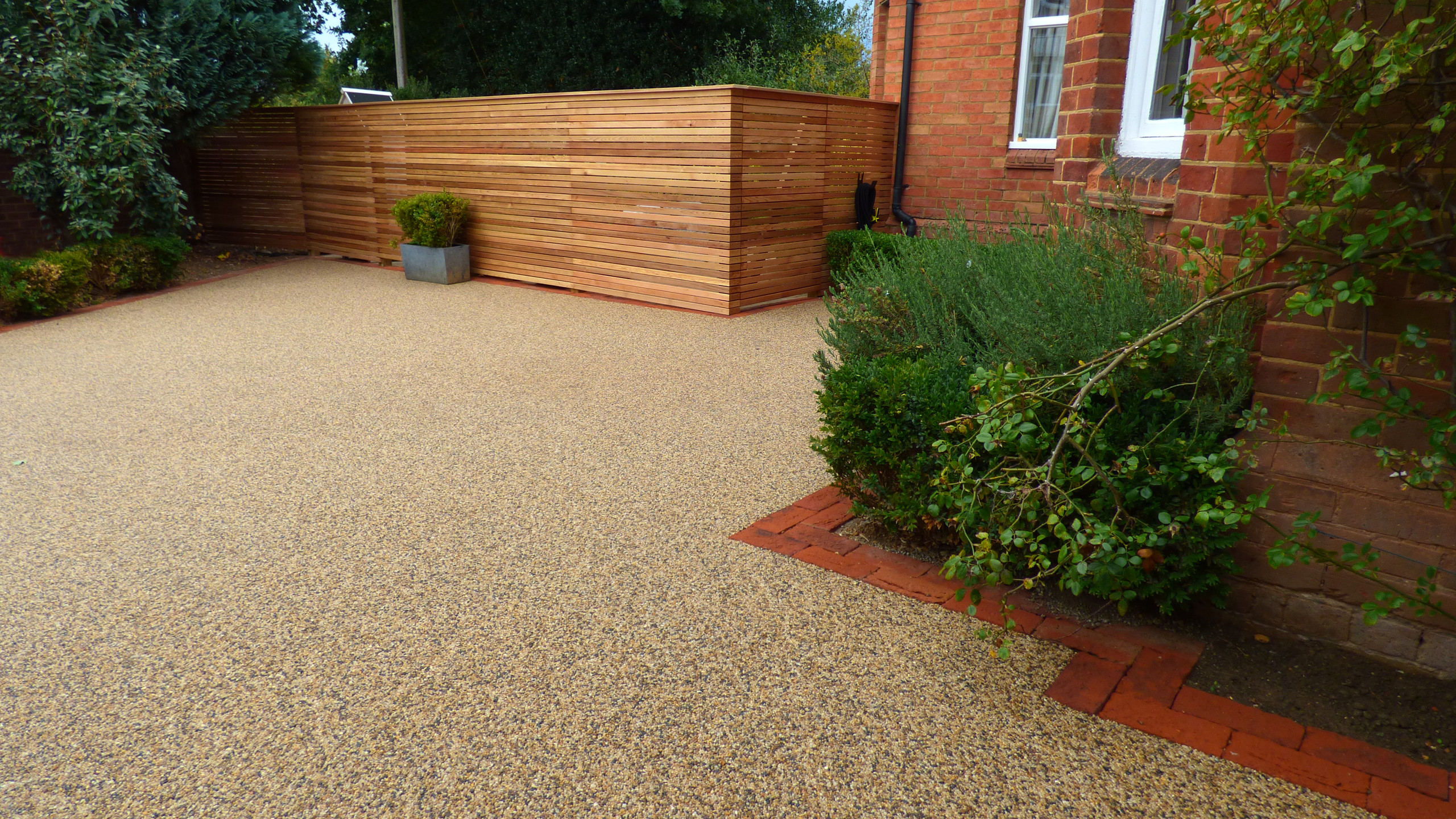 Resin Bound Driveway in 'Devon Yellow' edged with Keswick paving