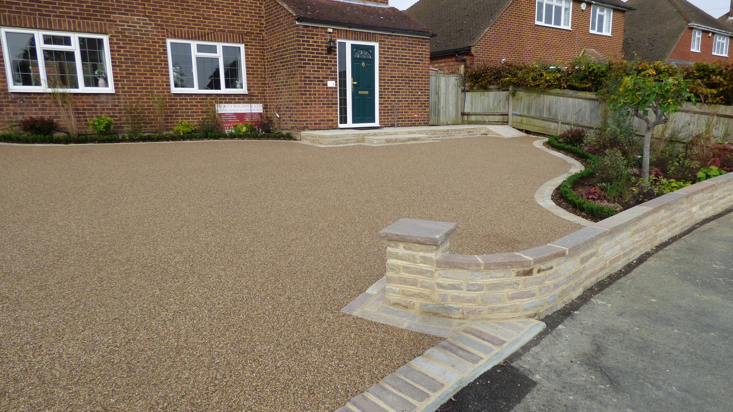 Resin Bound Driveway with tumbled sandstone edging.