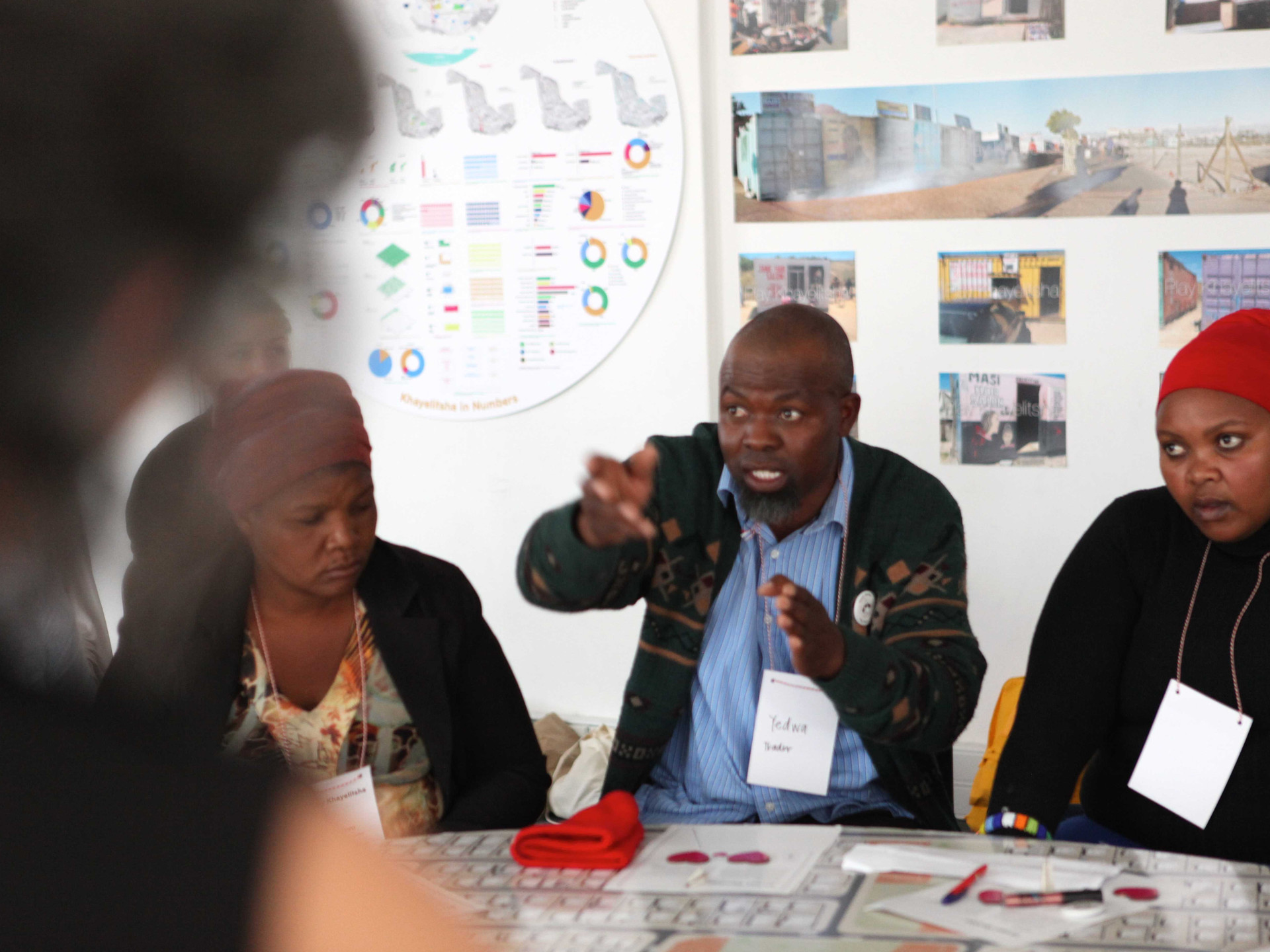 Trader Yedwa is explaining his vision for the Khayelitsha Centre Business District. -rents for formalised shops needs to be negotiated openly with the city; a standardisation for Cape Flats is desirable.