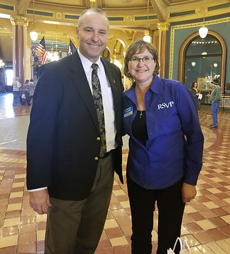 Kalen Peterson poses with Tim Kraayanbrink at the Statehous in Des Moines