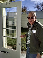 Dennis Den Hartog is an RSVP vounteer and a member of our Advisory Committee. He is shown here weatherizing a door for our winter weatherization project.