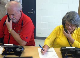 Terry and Gerry Greenfield from Story City learn how to staff a tip hotline for the Story County Sheriff's Office.
