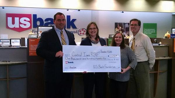Kalen Petersen accept a check from US Bank.