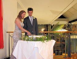 The Happy Couple cuts the cake