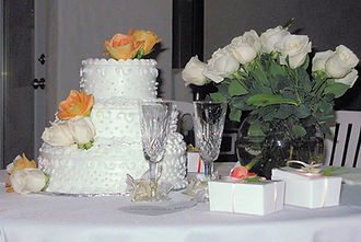 Traditional White & Apricot Wedding Cake Table