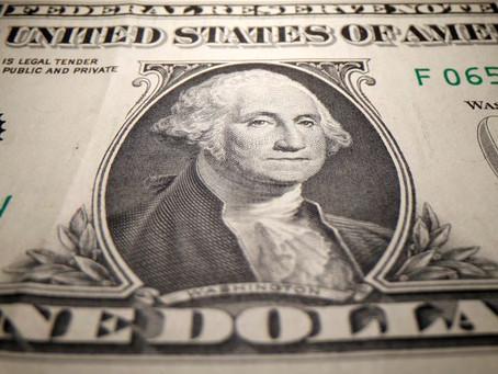 Dollar buoyed by upbeat U.S. economic data; Aussie falls