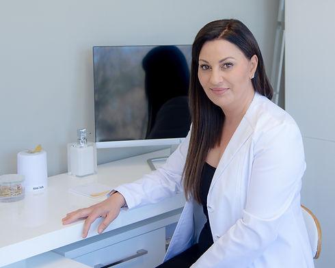 Dr E at Desk.jpg