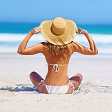 Woman enjoying her lipo treatment on the beach