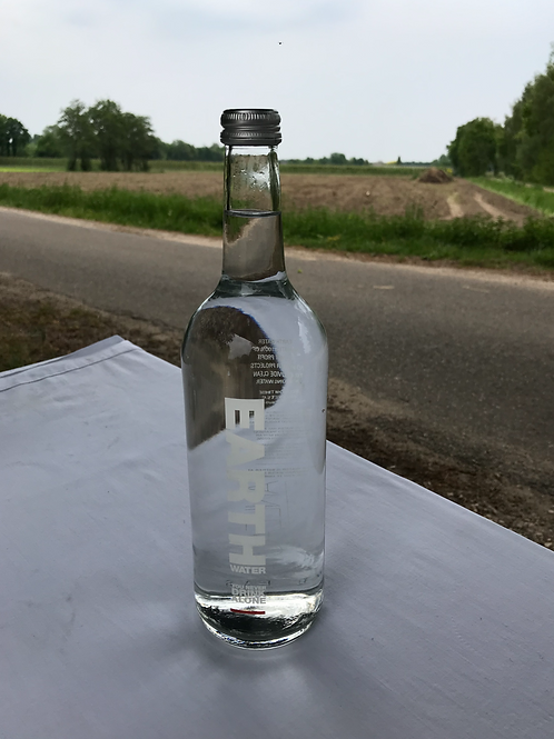 EARTH WATER 750ML. BOTTLED AT THE MINERAL WATER SOURCE: ANL'EAU TE ANNEN.
