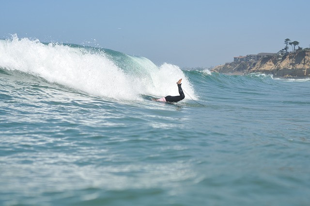 Surfer duck-diving a wave