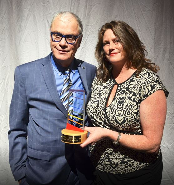 Paul Lomheim accepts his Builder of the Arts award from Arts Board Chair Roxanne Dicke. Photo by PA Daily Herald/Peter Lozinski