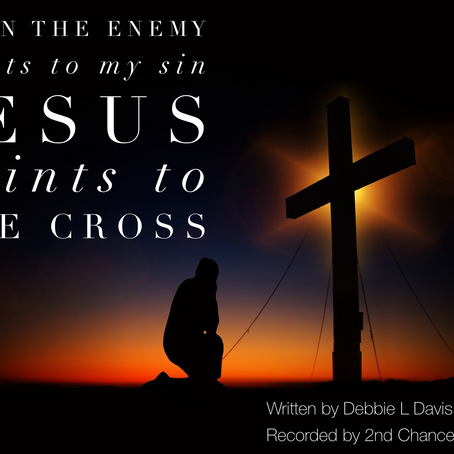 Jesus Points To The Cross