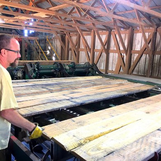 Employees visually inspect each board before transport to GF Hardwoods' kilns.