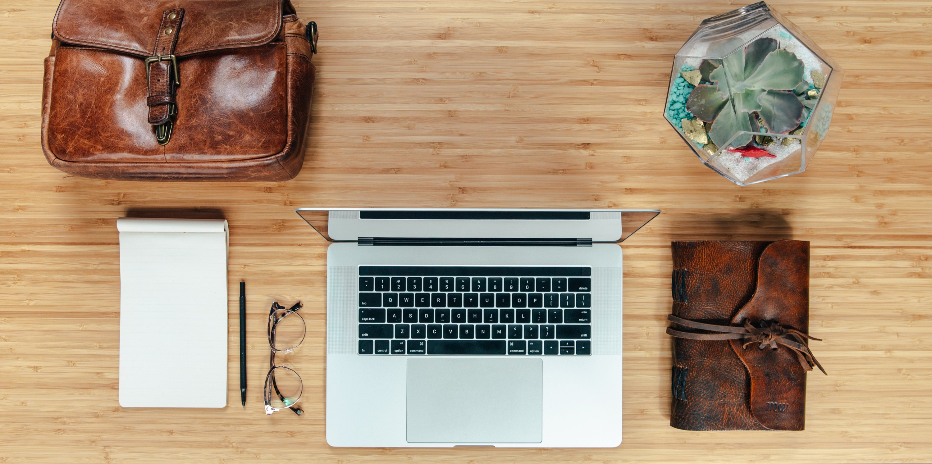 workspace-flatlay-with-leather-bag-and-n